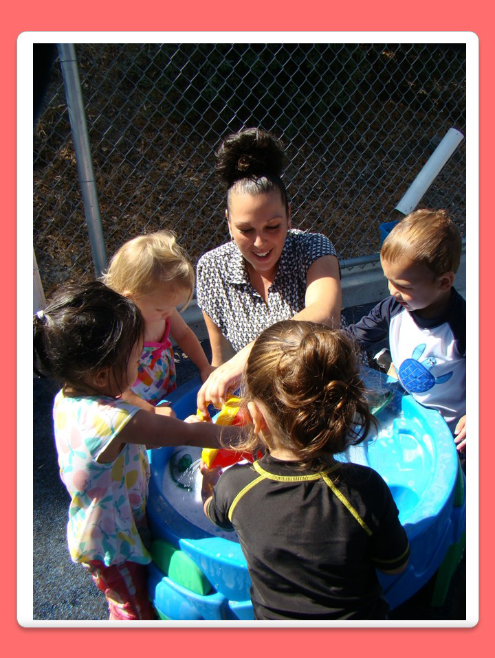 Ms. Angelina playing with kids with water