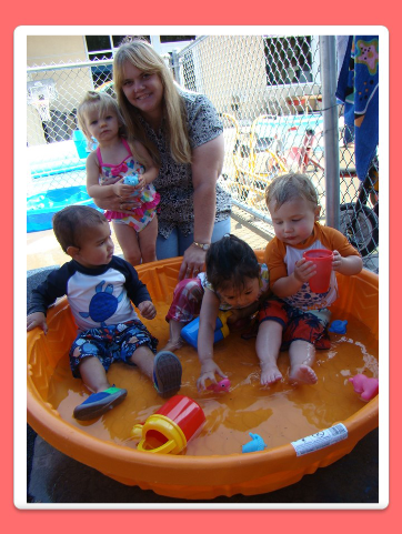 Ms. Tammy playing with kids in the pool